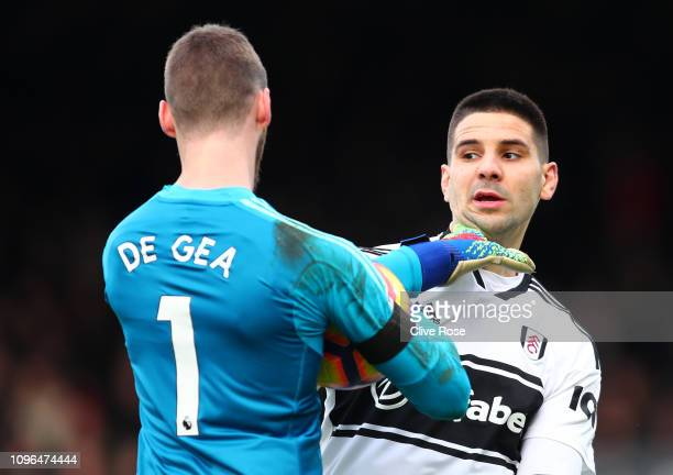 David De Gea of Manchester United clashes with Aleksandar Mitrovic during the Premier League match between Fulham FC and Manchester United at Craven...