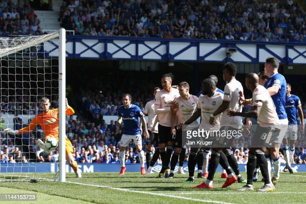 David De Gea of Manchester United clears the ball off the goal line during the Premier League match between Everton FC and Manchester United at...