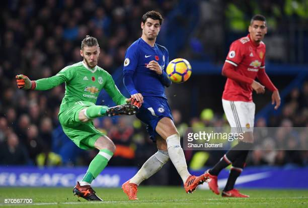 David De Gea of Manchester United clears the ball while under pressure from Alvaro Morata of Chelsea during the Premier League match between Chelsea...