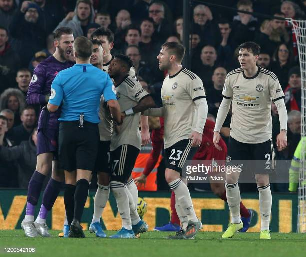 David de Gea of Manchester United complains to Referee Craig Pawson during the Premier League match between Liverpool FC and Manchester United at...
