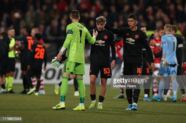 David de Gea of Manchester United congratulates Brandon Williams after the UEFA Europa League group L match between AZ Alkmaar and Manchester United...