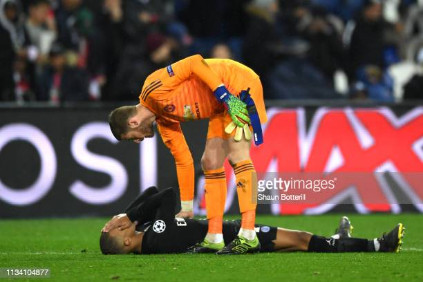 David De Gea of Manchester United consoles Kylian Mbappe of PSG after the full time whistle during the UEFA Champions League Round of 16 Second Leg...