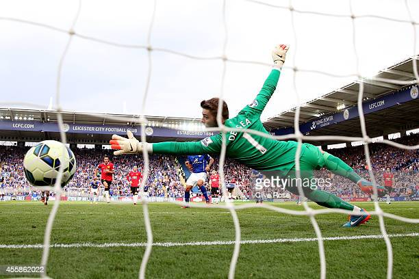 David De Gea of Manchester United dives in vain as Leonardo Ulloa of Leicester City scores his team's fifth goal from the penalty spot during the...