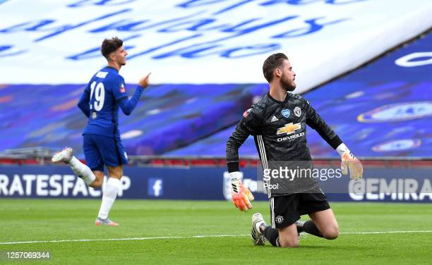 David De Gea of Manchester United fails to save the goal from Mason Mount of Chelsea as he celebrates after scoring his teams second goal during the...
