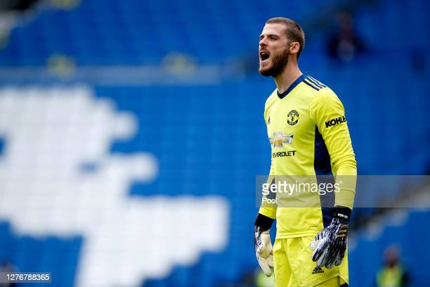 David De Gea of Manchester United gives his team instructions during the Premier League match between Brighton Hove Albion and Manchester United at...