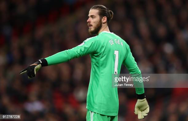 David De Gea of Manchester United gives instructions during the Premier League match between Tottenham Hotspur and Manchester United at Wembley...