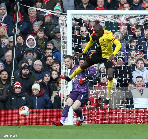 David de Gea of Manchester United in action with Abdoulaye Doucoure of Watford during the Premier League match between Manchester United and Watford...