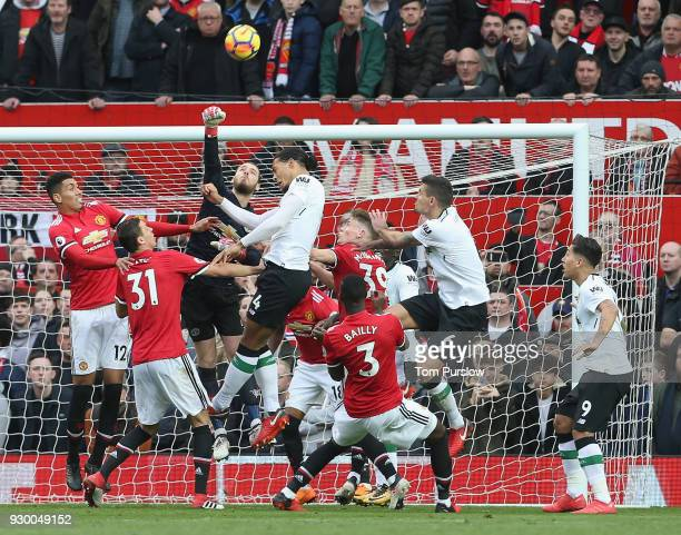 David de Gea of Manchester United in action with Virgil van Dijk of Liverpool during the Premier League match between Manchester United and Liverpool...