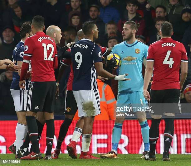 David de Gea of Manchester United in clashes with Salomon Rondon of West Bromwich Albion during the Premier League match between West Bromwich Albion...