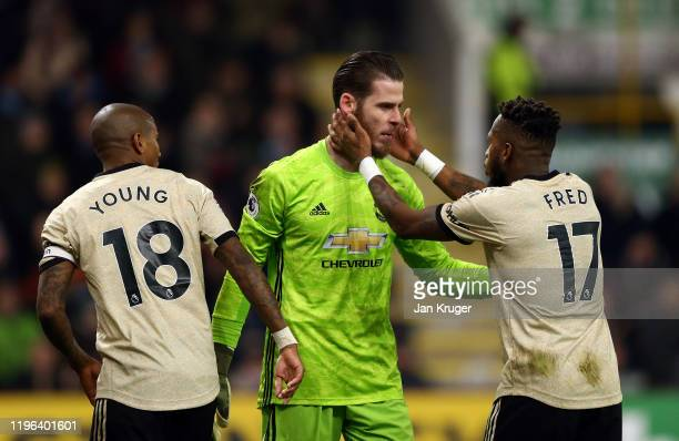 David De Gea of Manchester United is congratulated by teammate Fred after making a save during the Premier League match between Burnley FC and...