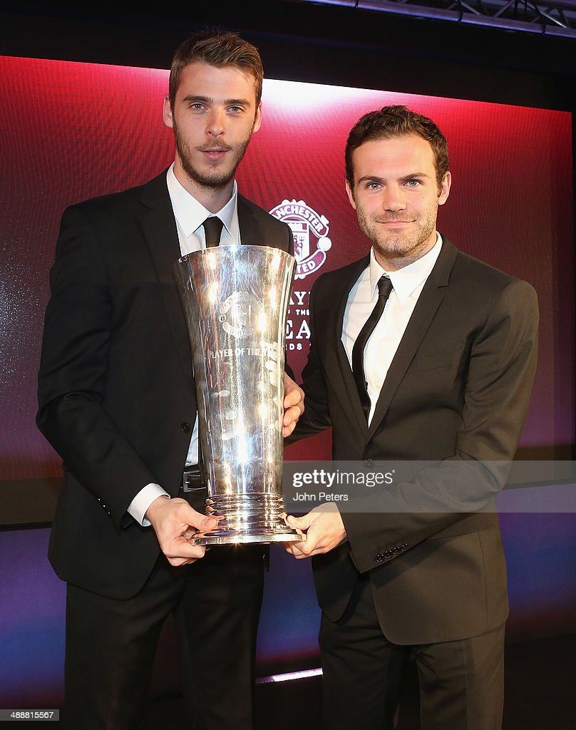 David de Gea of Manchester United is presented with the Players' Player of the Season award by Juan Mata at the Manchester United Player of the Year awards at Old Trafford on May 8, 2014 in Manchester, England.
