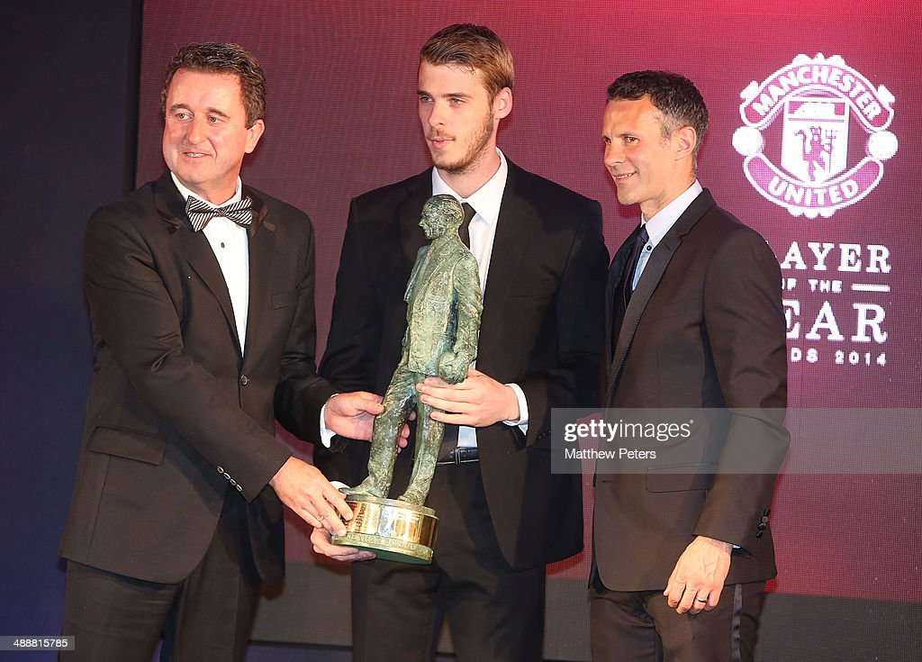 David de Gea of Manchester United is presented with the Sir Matt Busby Fans' Player of the Season award by Ryan Giggs and auction winner Steven Cross at the Manchester United Player of the Year awards at Old Trafford on May 8, 2014 in Manchester, England.