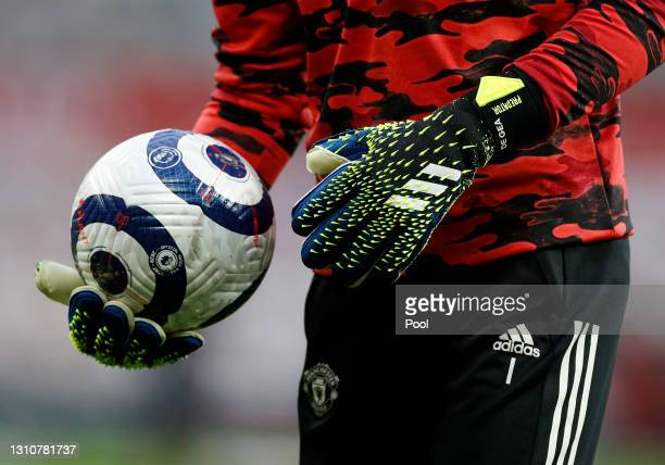 David De Gea of Manchester United is seen holding the blue and white Nike Flight Premier League ball prior to the Premier League match between...