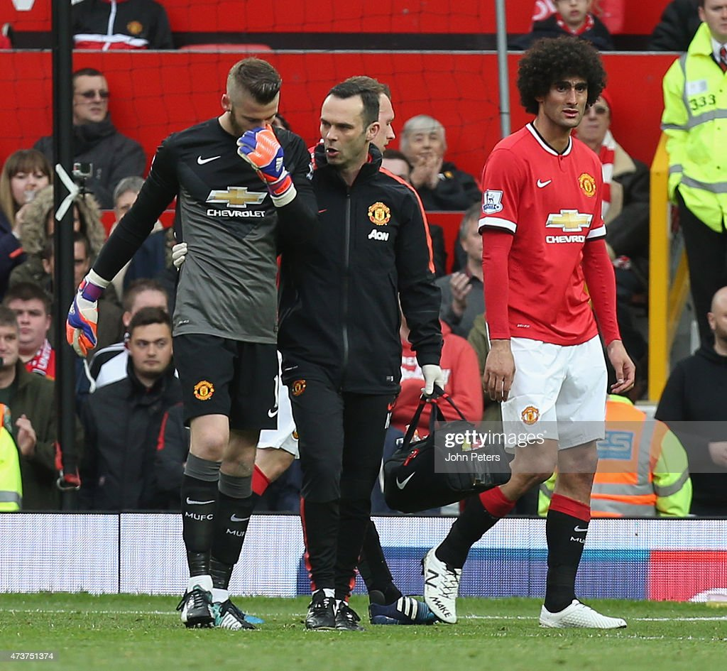 David de Gea of Manchester United leaves the pitch with an injury during the Barclays Premier League match between Manchester United and Arsenal at Old Trafford on May 17, 2015 in Manchester, England.