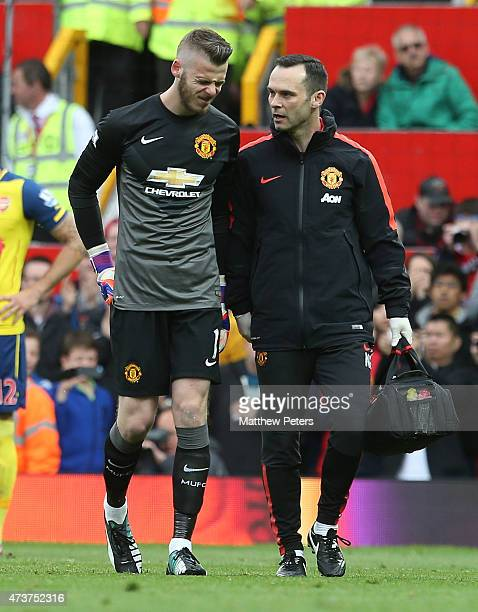 David de Gea of Manchester United leaves the pitch with an injury during the Barclays Premier League match between Manchester United and Arsenal at...