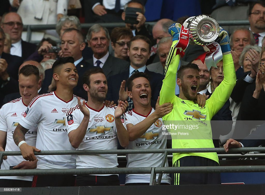 David de Gea of Manchester United lifts the FA Cup after The Emirates FA Cup final match between Manchester United and Crystal Palace at Wembley Stadium on May 21, 2016 in London, England.