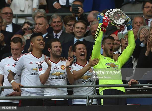 David de Gea of Manchester United lifts the FA Cup after The Emirates FA Cup final match between Manchester United and Crystal Palace at Wembley...