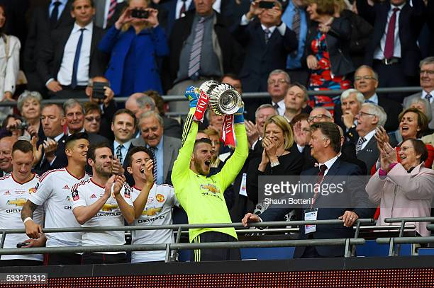 David De Gea of Manchester United lifts the trophy after winning The Emirates FA Cup Final match between Manchester United and Crystal Palace at...