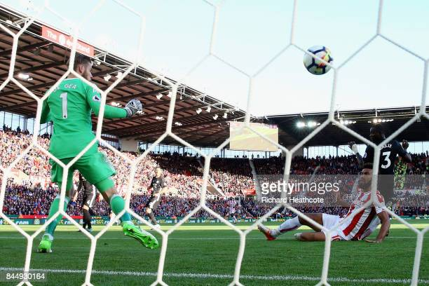 David De Gea of Manchester United looks back as Maxim ChoupoMoting of Stoke City scores his sides first goal during the Premier League match between...