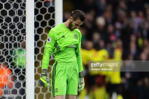 David De Gea of Manchester United looks dejected after failing to save a penalty which resulted in the second goal for Watford scored by Troy Deeney...