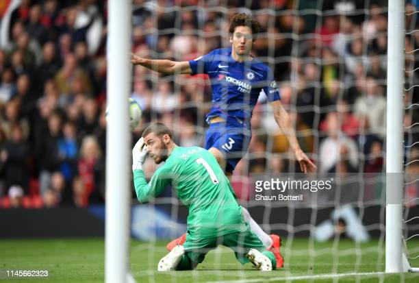 David De Gea of Manchester United looks on as he is beaten by Marcos Alonso of Chelsea as he scores his team's first goal during the Premier League...