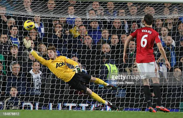 David de Gea of Manchester United makes a save during the Barclays Premier League match between Chelsea and Manchester United at Stamford Bridge on...