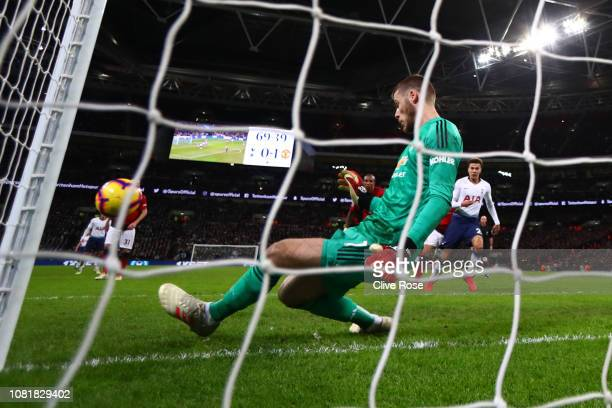 David De Gea of Manchester United makes a save during the Premier League match between Tottenham Hotspur and Manchester United at Wembley Stadium on...