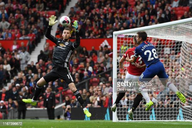 David De Gea of Manchester United makes a save during the Premier League match between Manchester United and Chelsea FC at Old Trafford on August 11...