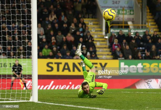 David De Gea of Manchester United makes a save during the Premier League match between Burnley FC and Manchester United at Turf Moor on December 28,...