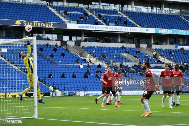 David De Gea of Manchester United makes a save during the Premier League match between Brighton Hove Albion and Manchester United at American Express...