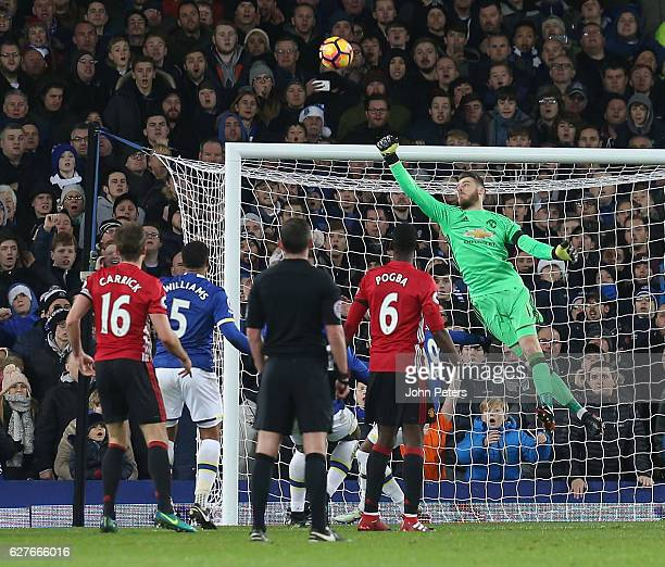 David de Gea of Manchester United makes a save during the Premier League match between Everton and Manchester United at Goodison Park on December 4...