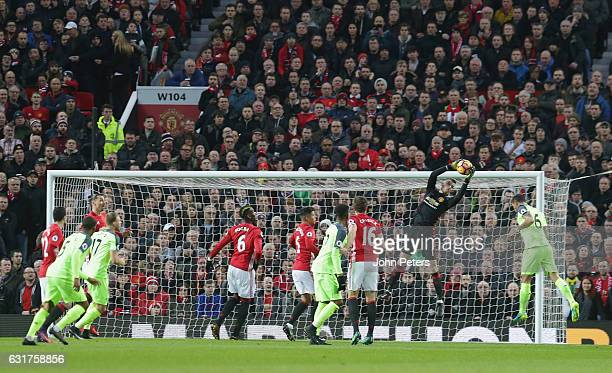David de Gea of Manchester United makes a save during the Premier League match between Manchester United and Liverpool at Old Trafford on January 15...