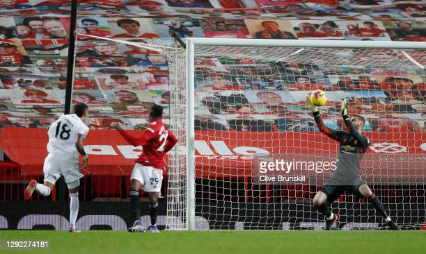 David De Gea of Manchester United makes a save from a shot from Raphinha of Leeds United during the Premier League match between Manchester United...