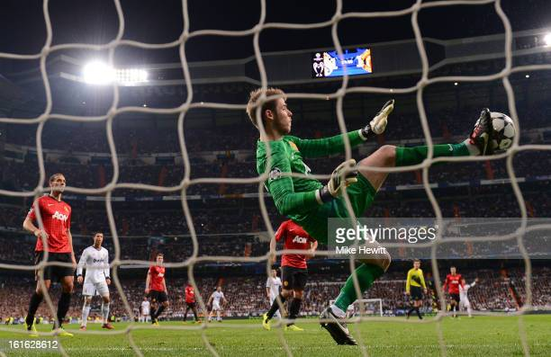 David De Gea of Manchester United makes a save with his foot during the UEFA Champions League Round of 16 first leg match between Real Madrid and...