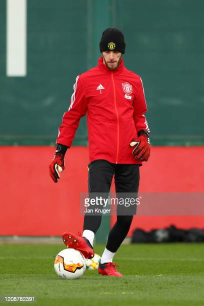 David De Gea of Manchester United passes the ball during a training session ahead of their UEFA Europa League round of 32 second leg match against...