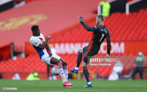David De Gea of Manchester United passes the ball through Wilfried Zaha of Crystal Palace legs during the Premier League match between Manchester...