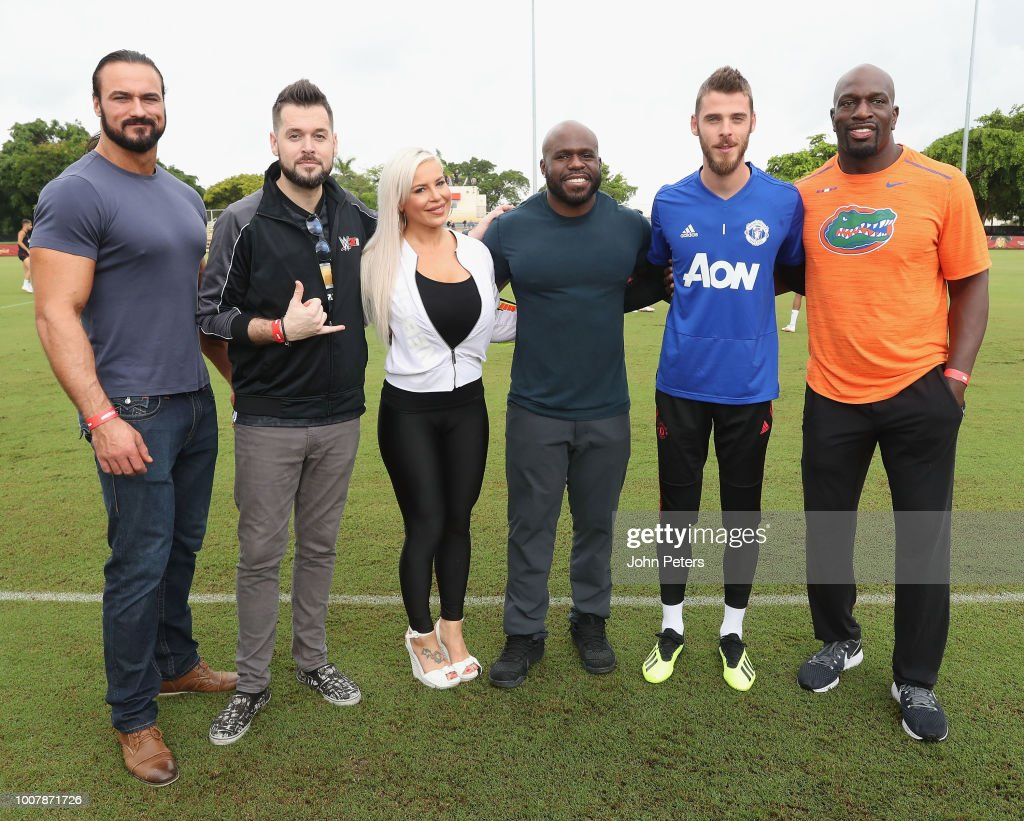 David de Gea of Manchester United pose with WWE announcer Mike Ford and wrestlers Drew McIntyre, Apollo Crews, Dana Brooke and Titus O'Neil after a training session as part of their pre-season tour of the USA at Barry University on July 30, 2018 in Miami, Florida.