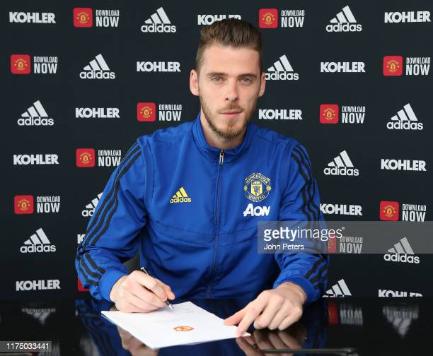 David de Gea of Manchester United poses after signing a new contract with the club at Aon Training Complex on September 16, 2019 in Manchester,...