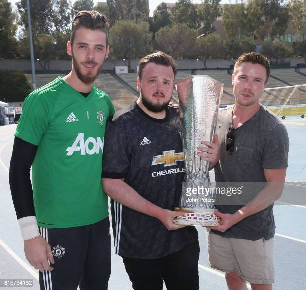 David de Gea of Manchester United poses with Game of Thrones actors John Bradley-West and Joe Dempsie and the UEFA Europa League trophy ahead of a...