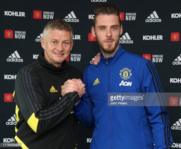 David de Gea of Manchester United poses with Manager Ole Gunnar Solskjaer after signing a new contract with the club at Aon Training Complex on...