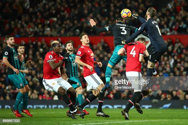 David De Gea of Manchester United punhces clear from Maya Yoshida of Southampton during the Premier League match between Manchester United and...