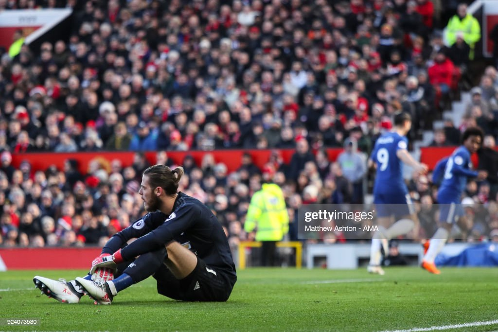 David de Gea of Manchester United reacts after Willian of Chelsea scores a goal to make it 0-1 during the Premier League match between Manchester United and Chelsea at Old Trafford on February 25, 2018 in Manchester, England.