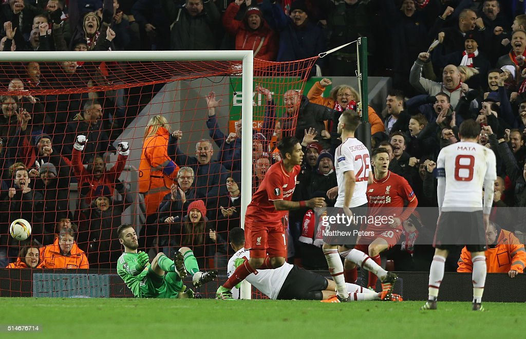 David de Gea of Manchester United reacts to conceding a goal to Roberto Firmino of Liverpool during the UEFA Europa League round of 16 first leg match between Liverpool and Manchester United at Anfield on March 10, 2016 in Liverpool, United Kingdom.