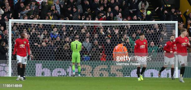 David de Gea of Manchester United reacts to conceding a penalty to Troy Deeney of Watford during the Premier League match between Watford FC and...