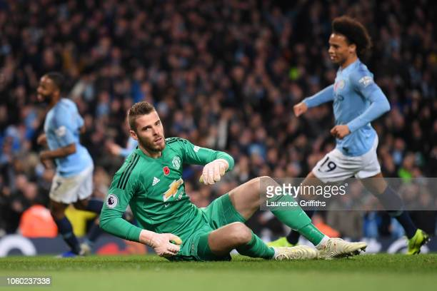 David De Gea of Manchester United reacts to conceding Manchester City's third goal during the Premier League match between Manchester City and...