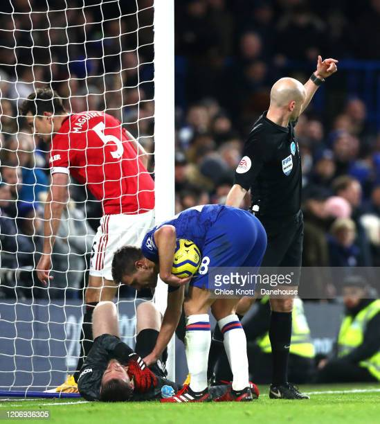 David De Gea of Manchester United receives medical attention during the Premier League match between Chelsea FC and Manchester United at Stamford...