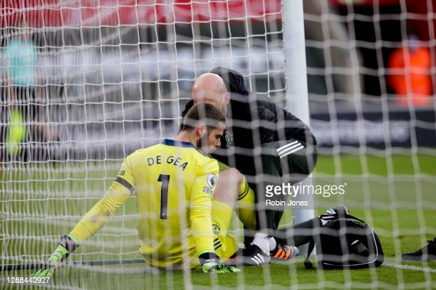 David De Gea of Manchester United receives treatment which prevents him from playing second half during the Premier League match between Southampton...