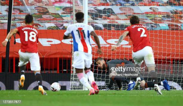 David De Gea of Manchester United saves a penalty from Jordan Ayew of Crystal Palace although a VAR review leads to the penalty then being retaken...