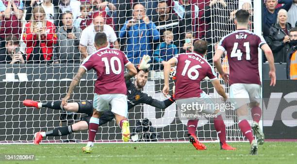 David de Gea of Manchester United saves a penalty from Mark Noble of West Ham United during the Premier League match between West Ham United and...