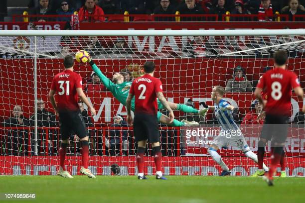 David De Gea of Manchester United saves a shot during the Premier League match between Manchester United and Huddersfield Town at Old Trafford on...